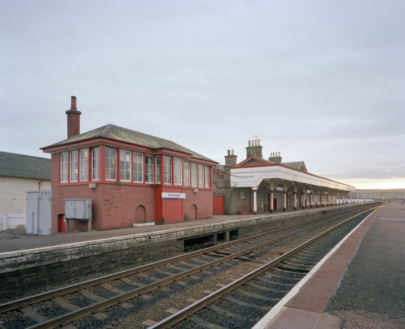 General view from N of signal box (left), station offices and south-bound platform and awning