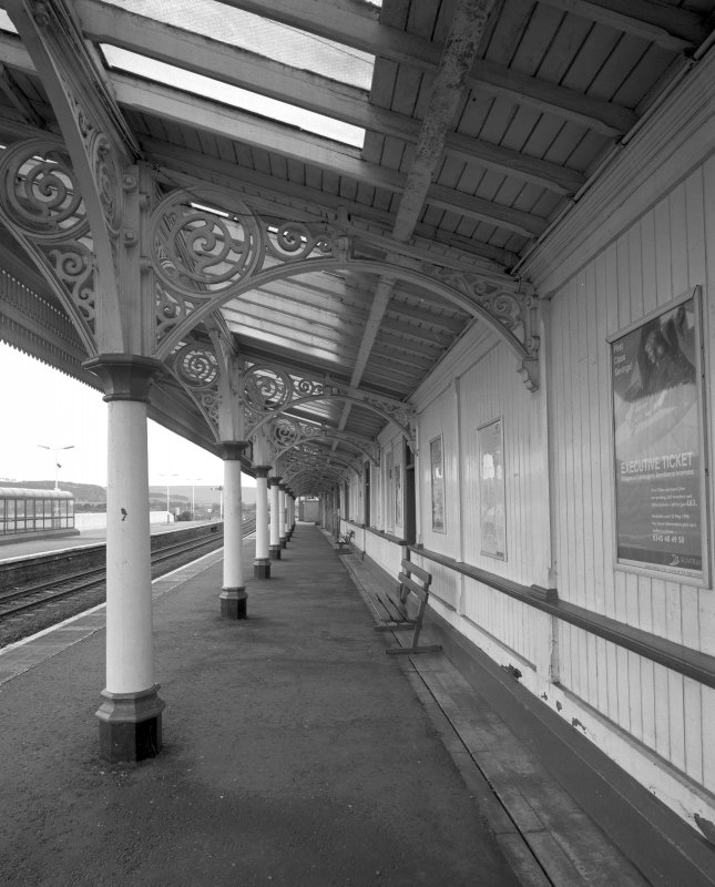 Detailed view from SW along south-bound platform, showing ornate cast-iron columns and trusses supporting awning