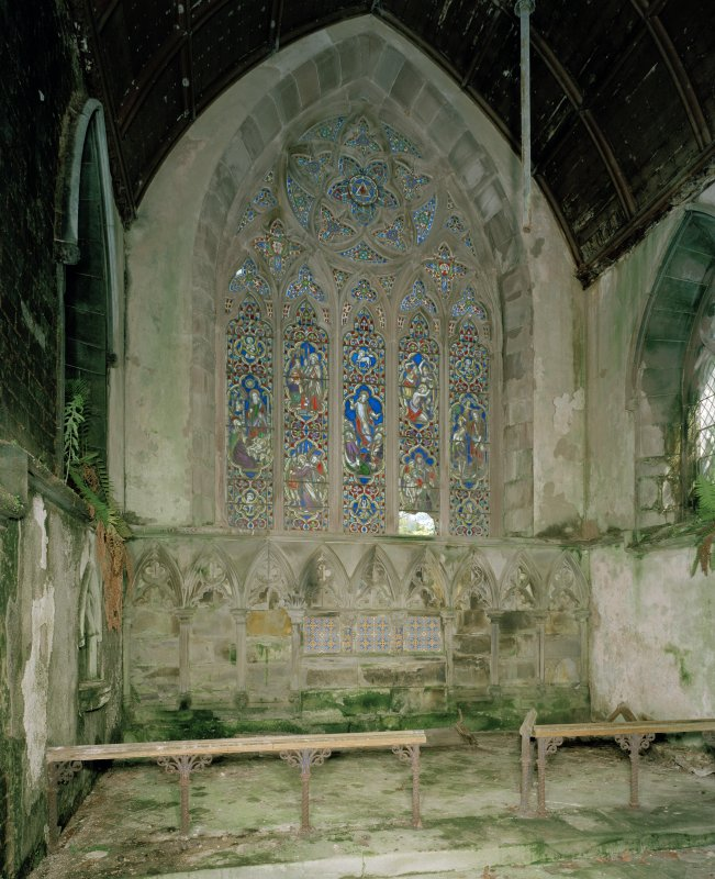View of chancel: including East wall and stained glass window