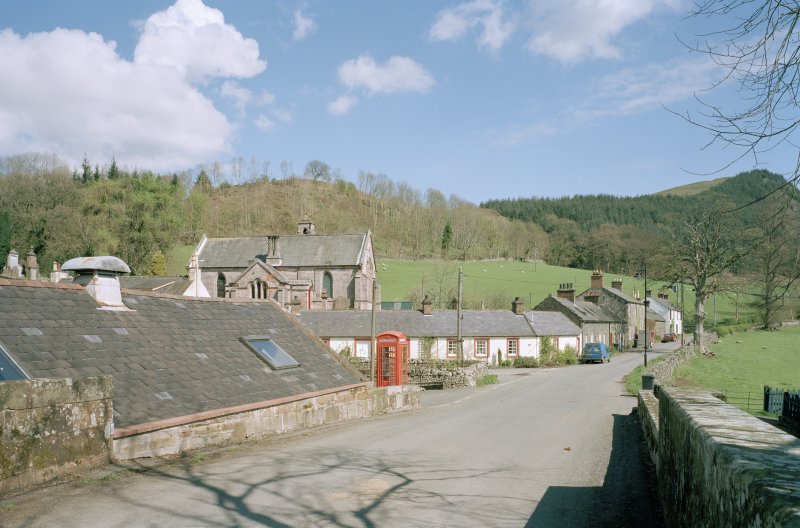 View of church in village setting from S