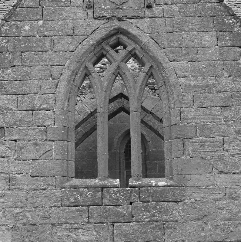 Fearn Abbey.  Ross aisle, detail of traceried window, Ross armorial, from North.