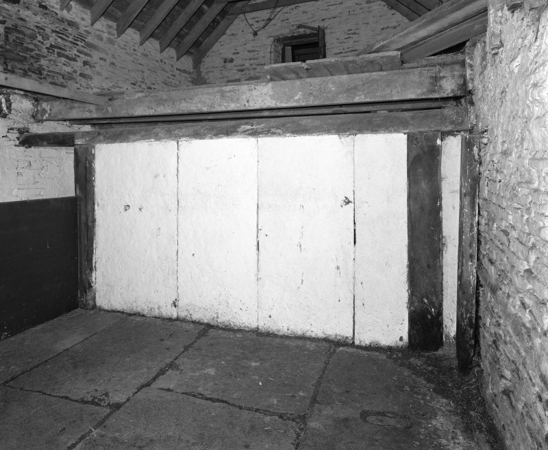 Stable, (former steading), interior view of stall showing Caithness slabs.