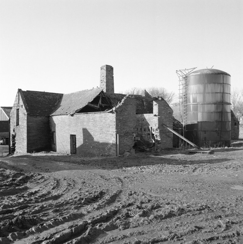 View of threshing barn and grain silo from North East.