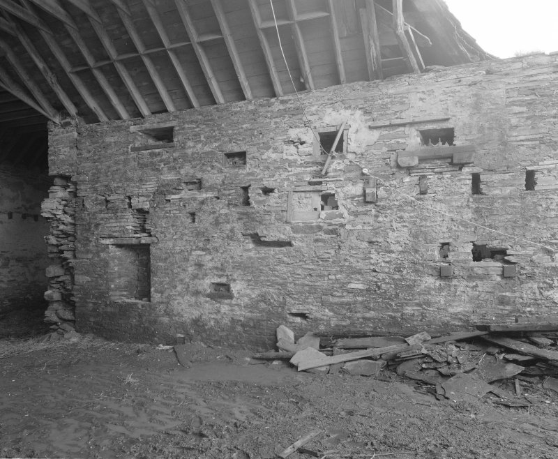 View of interior of threshing barn from North East.