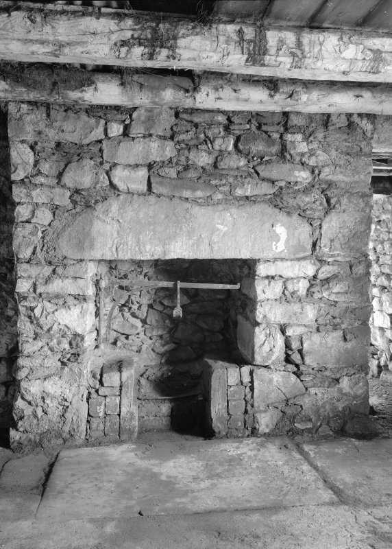 Auchindrain, Building D, interior. View of fireplace with swee.