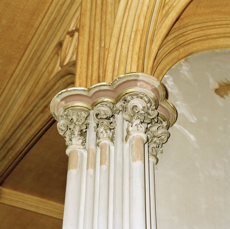 Detail of east end capital showing former colour scheme with graining and gilding
