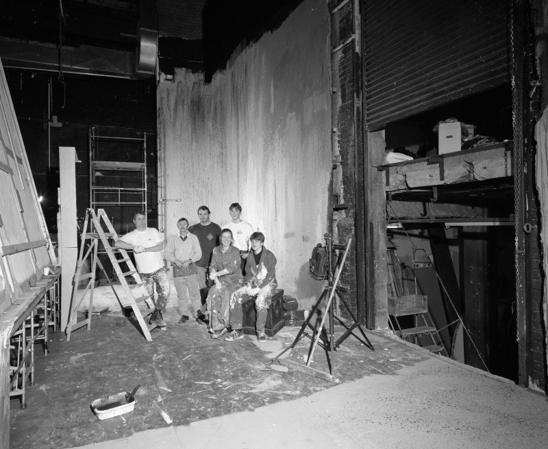 "View of backstage area with ""stage crew"""