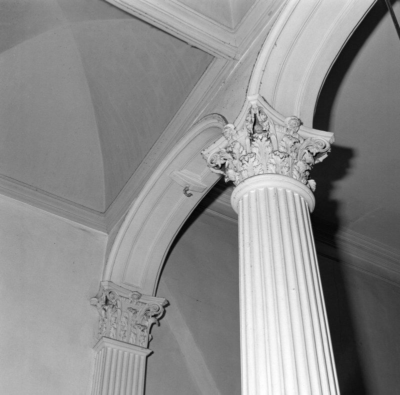 Staircase hall, arch supported by Corinthian column and pilaster, detail