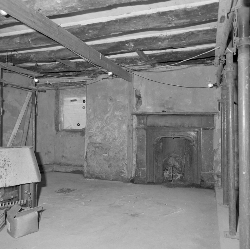 Interior. View of ground floor W room from SW.