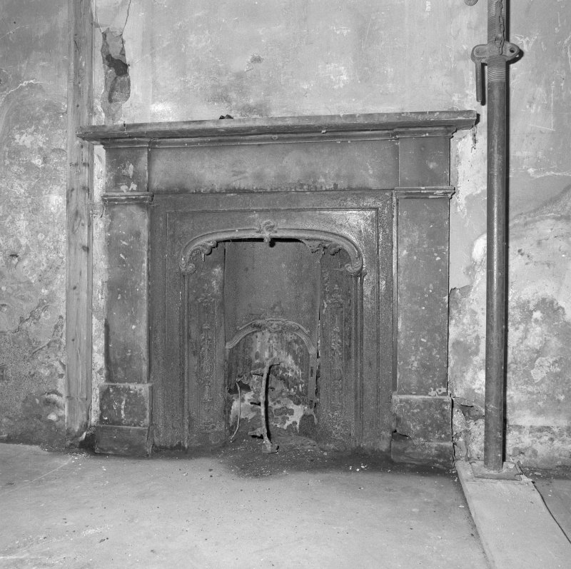 Interior. Detail of ground floor E room fireplace.