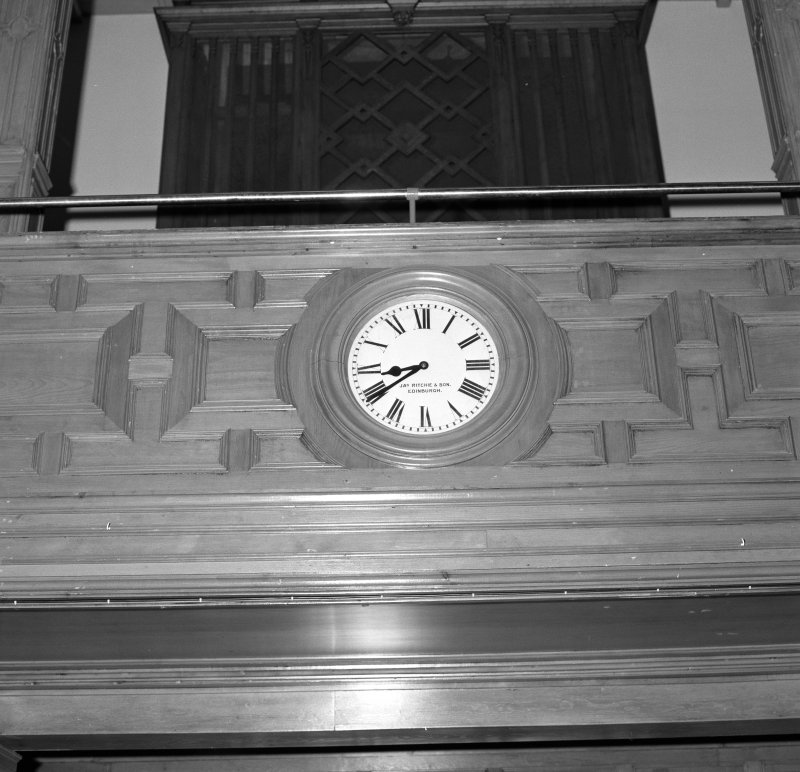 Interior. Assembly Hall detail of gallery front and clock