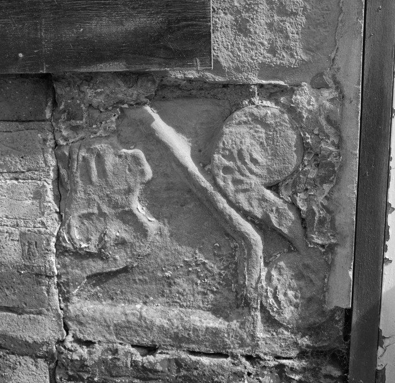 Former stable, detail of carved stone in door pillar