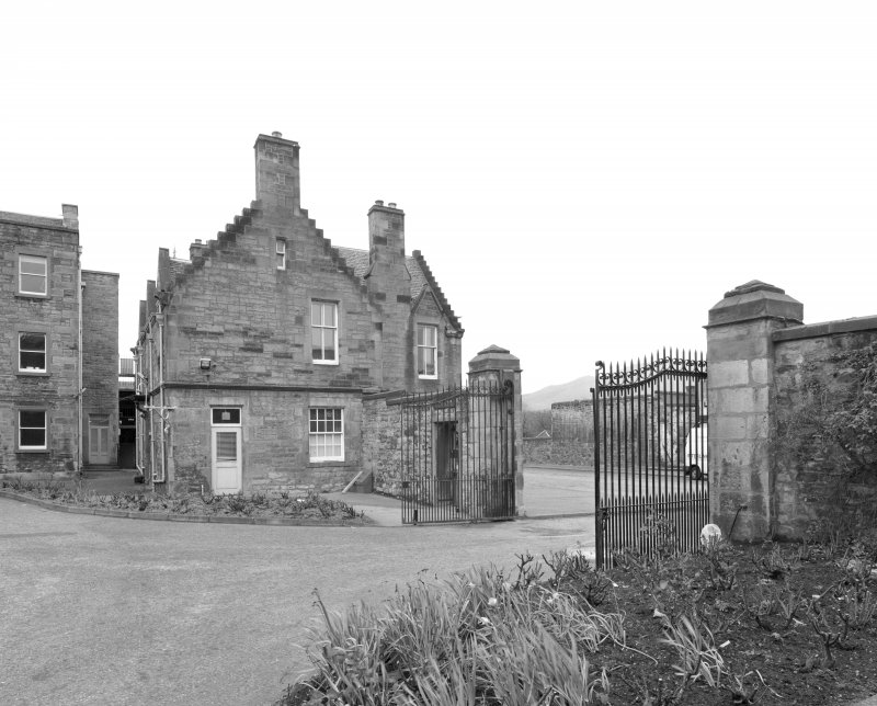 View of lodge and gates from W