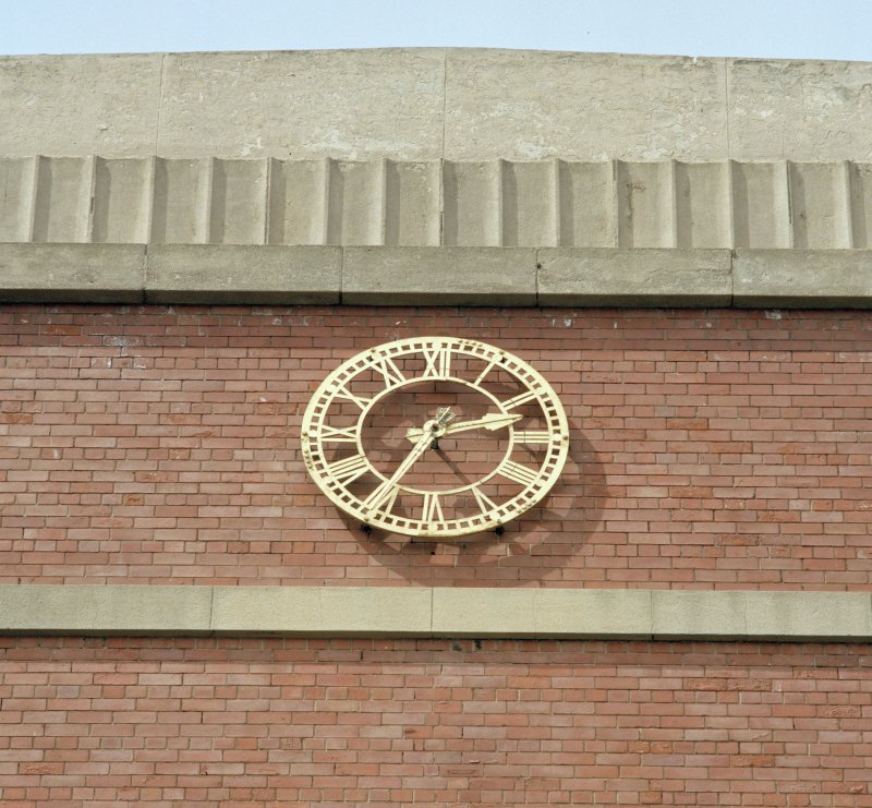 Detail of clock on 1930's brick building