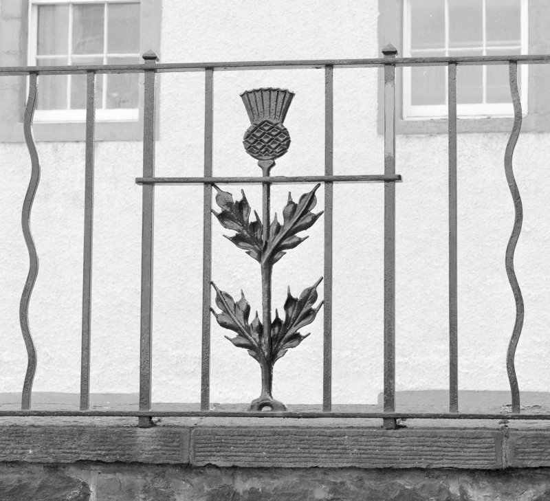 Detail of thistle ironwork on Queensberry House perimeter wall
