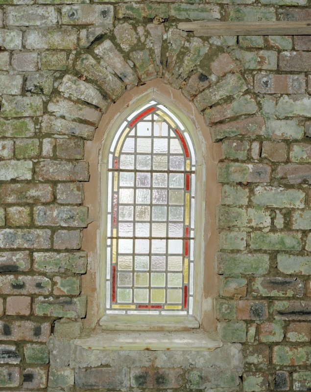 Detail of leaded glass window in E wall of church