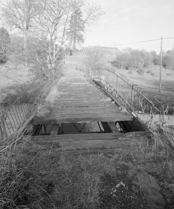 Linlathen East Bridge View from S looking along wooden deck of bridge, also showing details of remains of parapet and added fencing