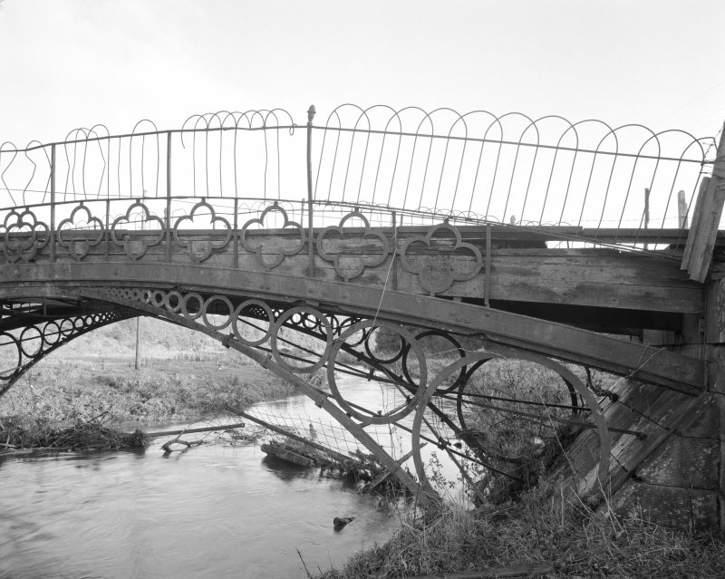 Linlathen East Bridge Detailed half-view of bridge showing typical iron spandrel and quatrefoil parapet, with added fencing