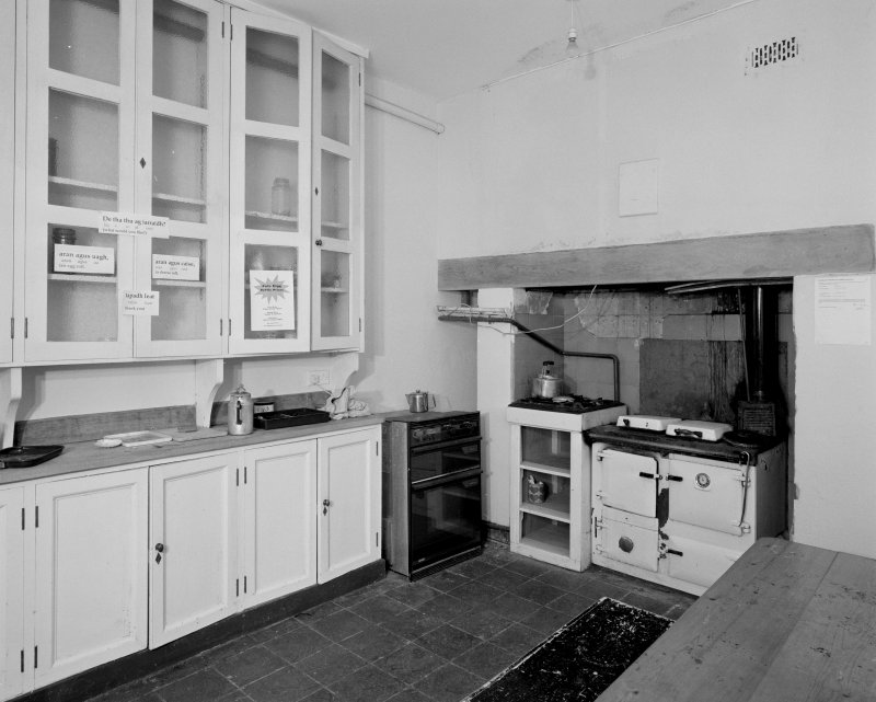 Ground floor kitchen, view from North showing original cabinets