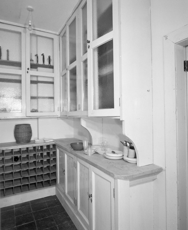 Ground floor pantry, view from West showing original fitments