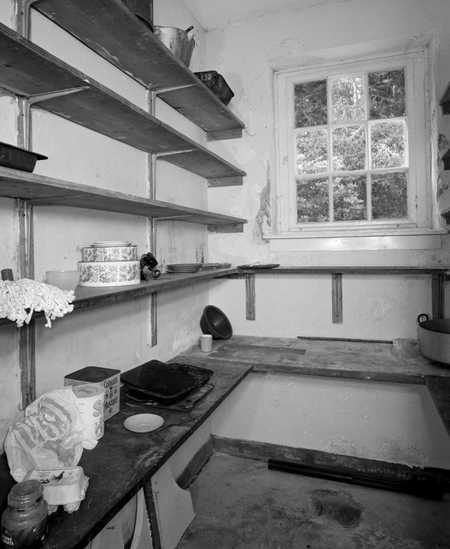 Ground floor larder, view from East showing slate shelves