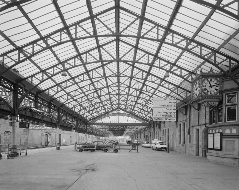 Perth, Leonard Street, General Station Platforms 7 (left) and 8 & 9 (ahead):  view from south south east beneath ornate glazed canopy, also showing clock (right)