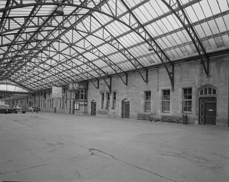 Perth, Leonard Street, General Station Platforms 8 & 9 (left): oblique view from south west beneath steel-framed glazed canopy showing west facade of main station offices, including ornate clock