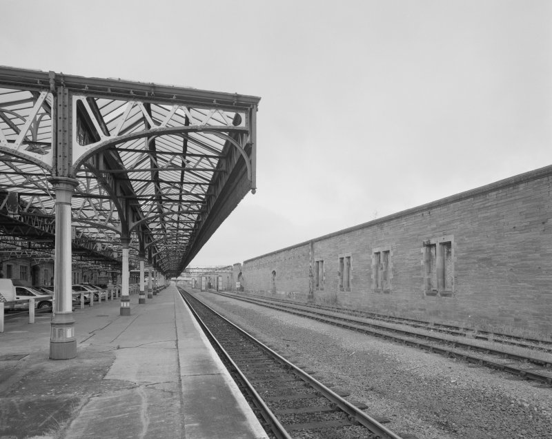 Perth, Leonard Street, General Station Platform 7:  view from north at north end of station, showing (right) remains of wall once forming the east side of a former car shed on the west side of the station