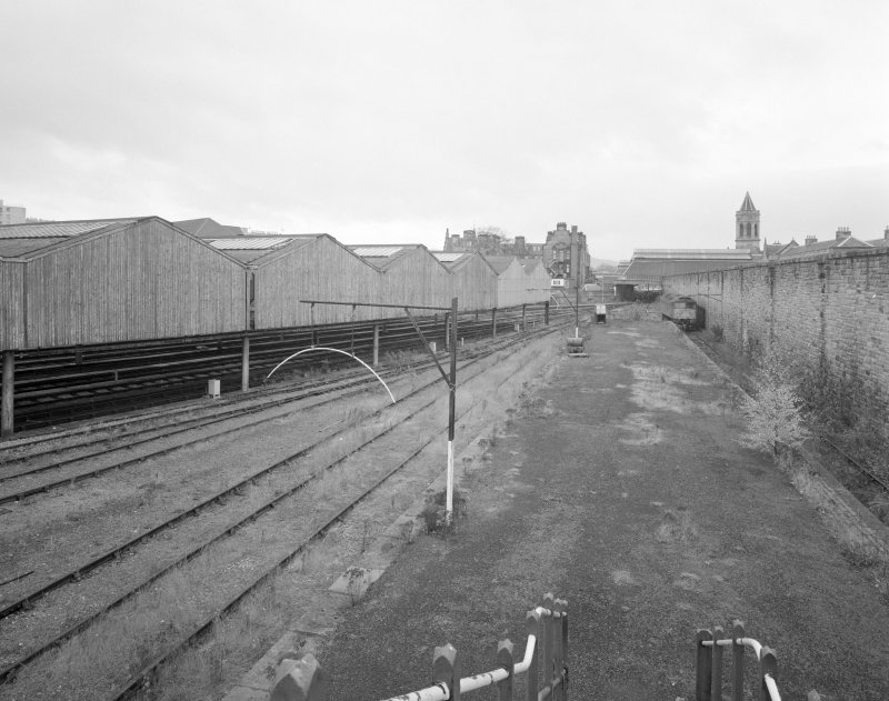 Perth, Leonard Street, General Station Elevated general view (on footbridge) from north, showing station in distance, and surviving block of carriage sheds (left).  The Station Hotel is also visible in the distance (centre)