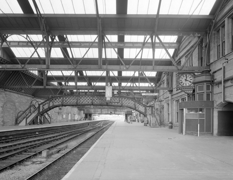 Perth, Leonard Street, General Station Platforms 3 (left) and 4 (centre): general view from north west under main canopy, showing footbridge linking to the two platforms, and a second ornate clock