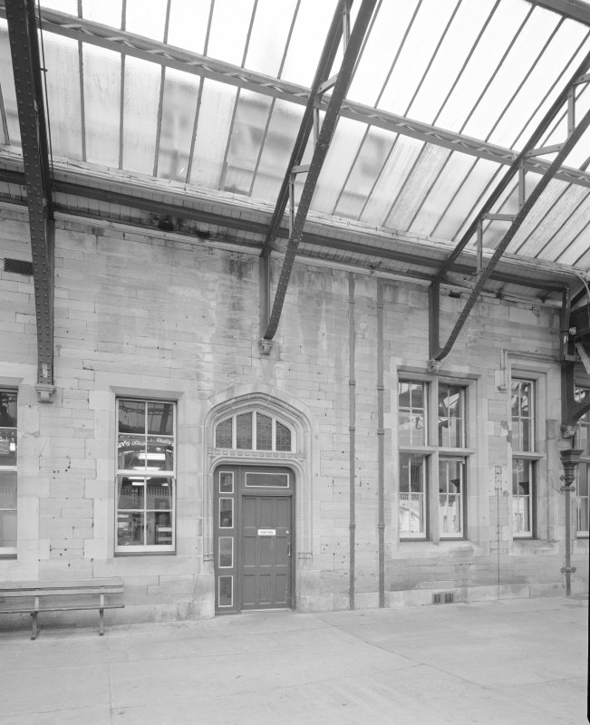 Perth, Leonard Street, General Station Platform 7: detail of portion of west facade of main Station offices, showing door, windows, and rainwater downpipes recessed into dressed-stone facade
