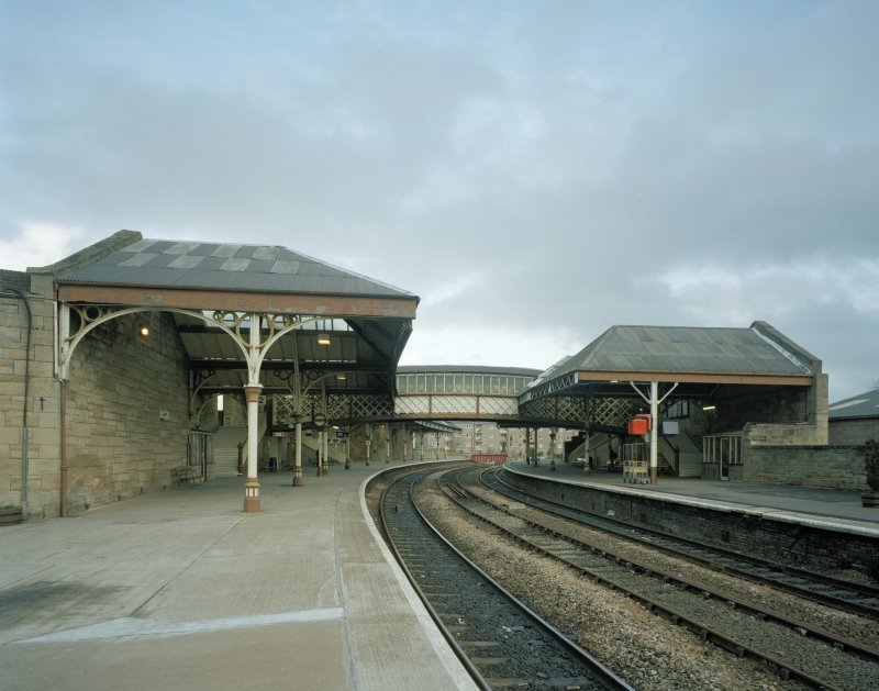 Perth, Leonard Street, General Station Platforms 1 & 2: view from south west showing canopies of platforms and connecting footbridge.  These platforms serve trains to and from Dundee and Aberdeen (and intermediate stations)