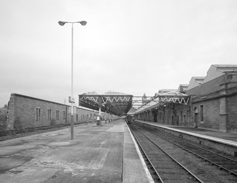 Perth, Leonard Street, General Station Platforms 7 (left) and 6 (right): view from south south east, showing east wall of former neighbouring car shed to west (left), and Station offices (right)