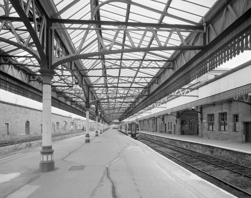 Perth, Leonard Street, General Station Platforms 7 (left) and 6 (right): view from south south east, showing steel-framed glazed platform canopies (on ornate cast-iron columns) and Station offices (right)