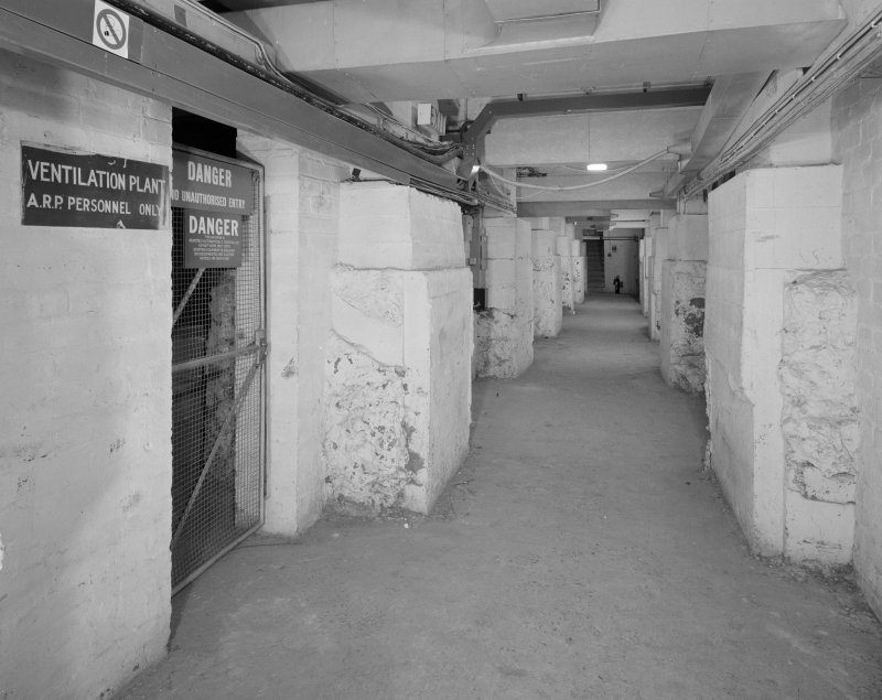 Interior. Basement, view of former shelter area showing sign
