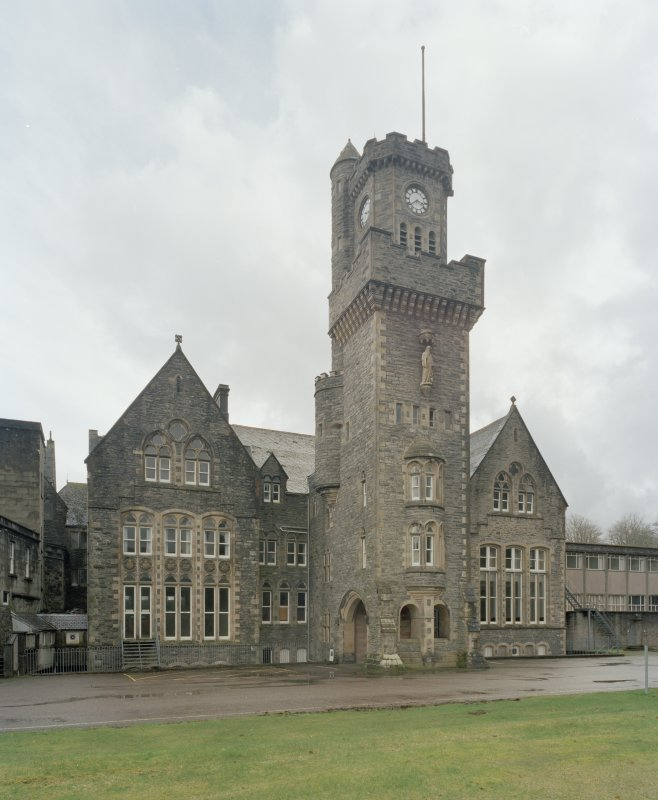 View of North West entrance tower and old school from North
