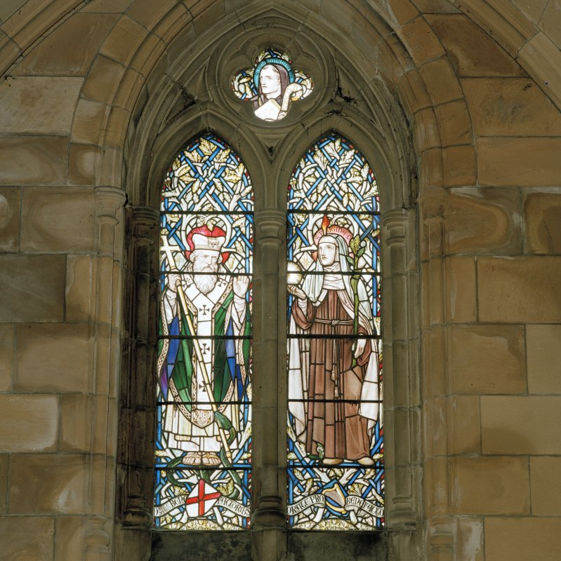 Detail of 19th century South West aisle stained glass windows of St Patrick and St Bridget