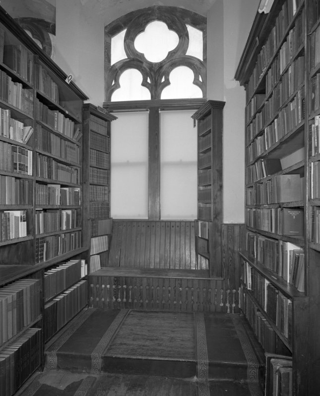 Detail of library shelving and window seat