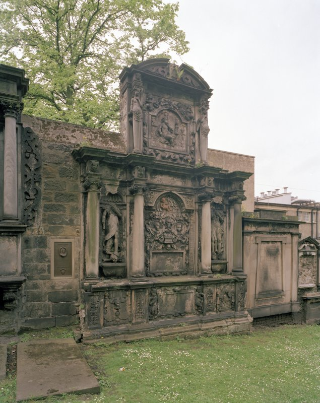View of funerary monument on west wall of churchyard.