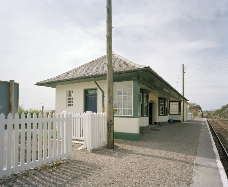 Oblique view from E of main station building, containing former booking office