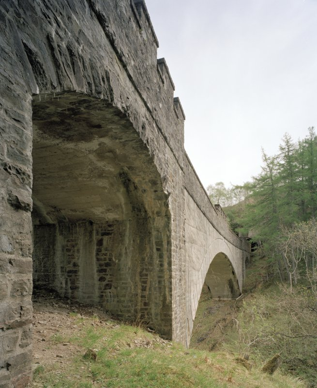 Borrodale Viaduct Oblique view from south west of south side of viaduct, showing west arch (foreground), and main span over Borrodale Burn