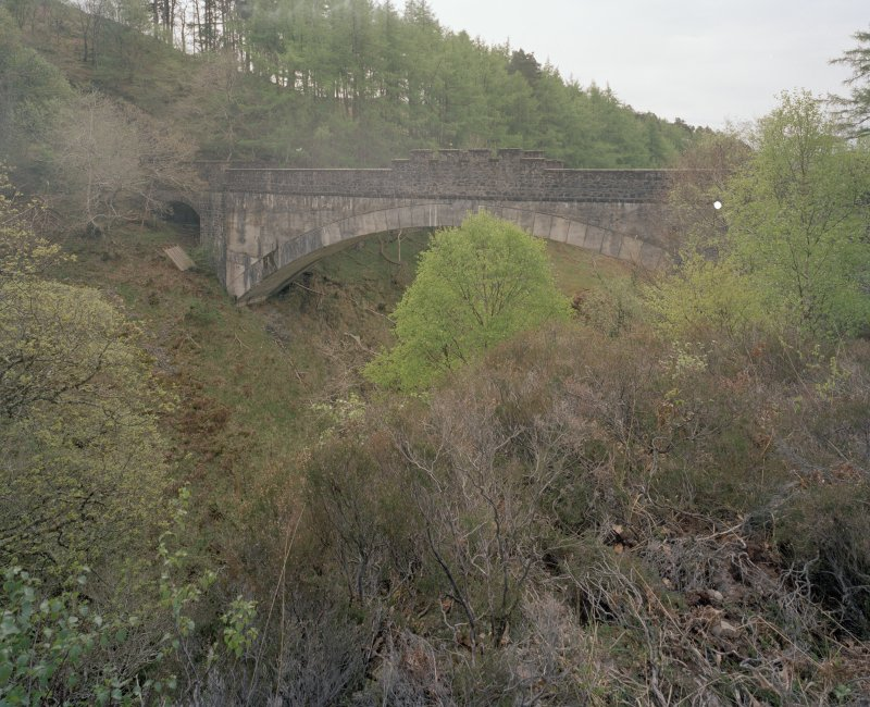 Borrodale Viaduct Partly obscured view from north of north of main span of the viaduct, with the east arch also visible (left)