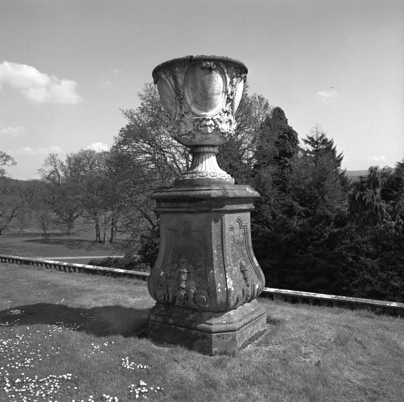 Detail of urn and plinth on terrace to East of castle.