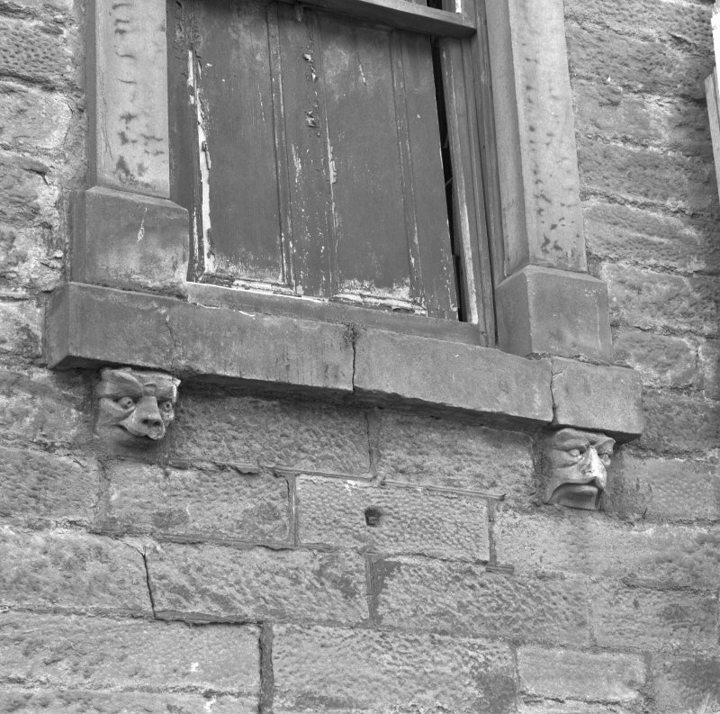 Detail of carved masks on keystones and console brackets
