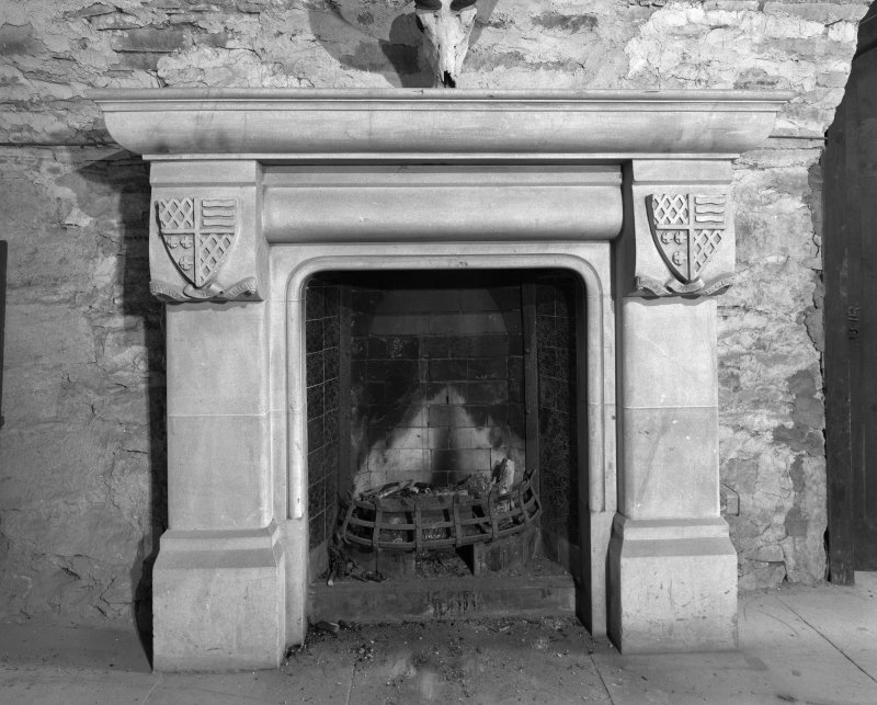 Ground floor, vaulted room, detail of fireplace..
