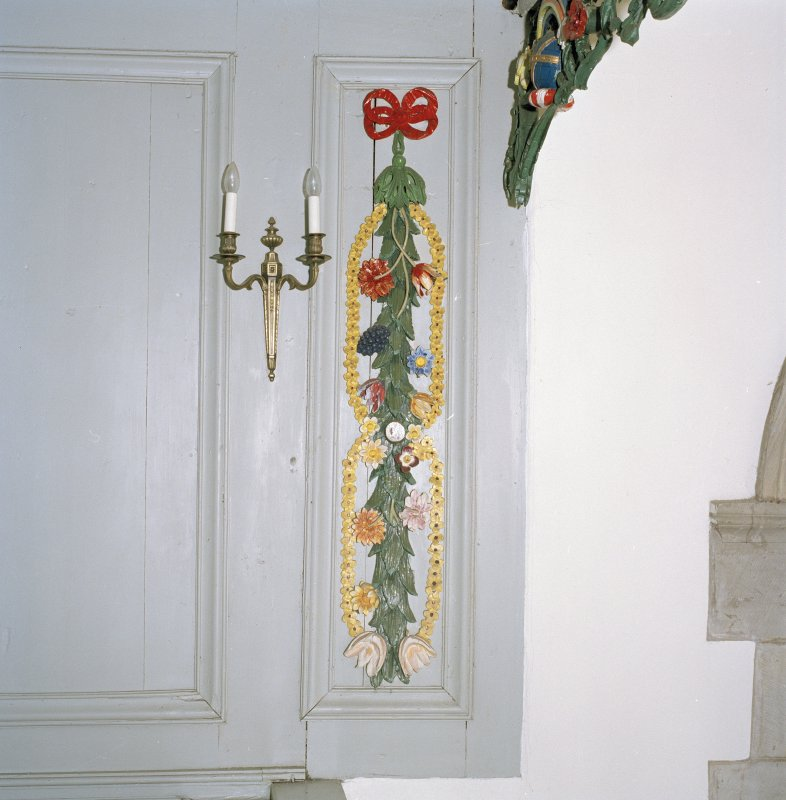 Interior. Detail of painted carved decoration at side of balcony of Hopetoun Loft.