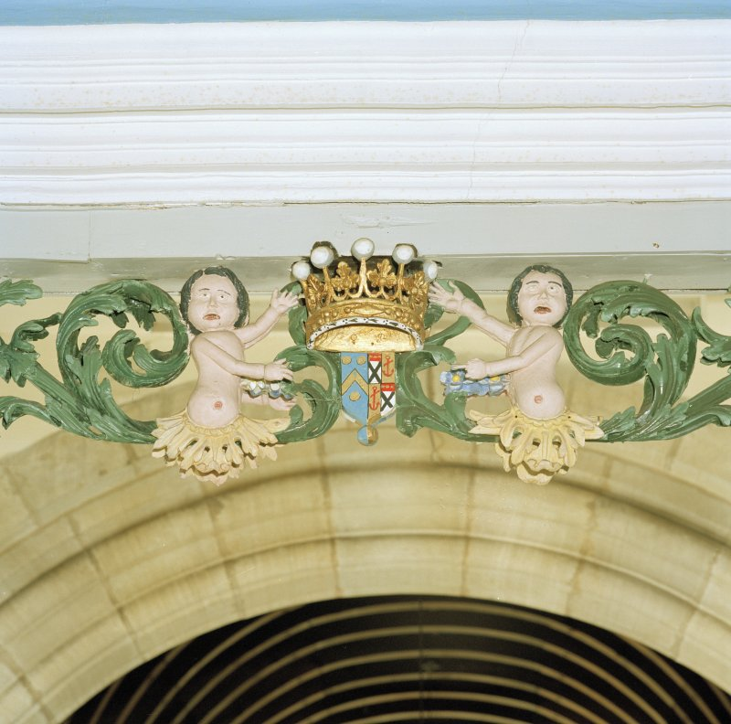 Interior. Detail of carved coat of arms with figures above balcony in Hopetoun Loft.
