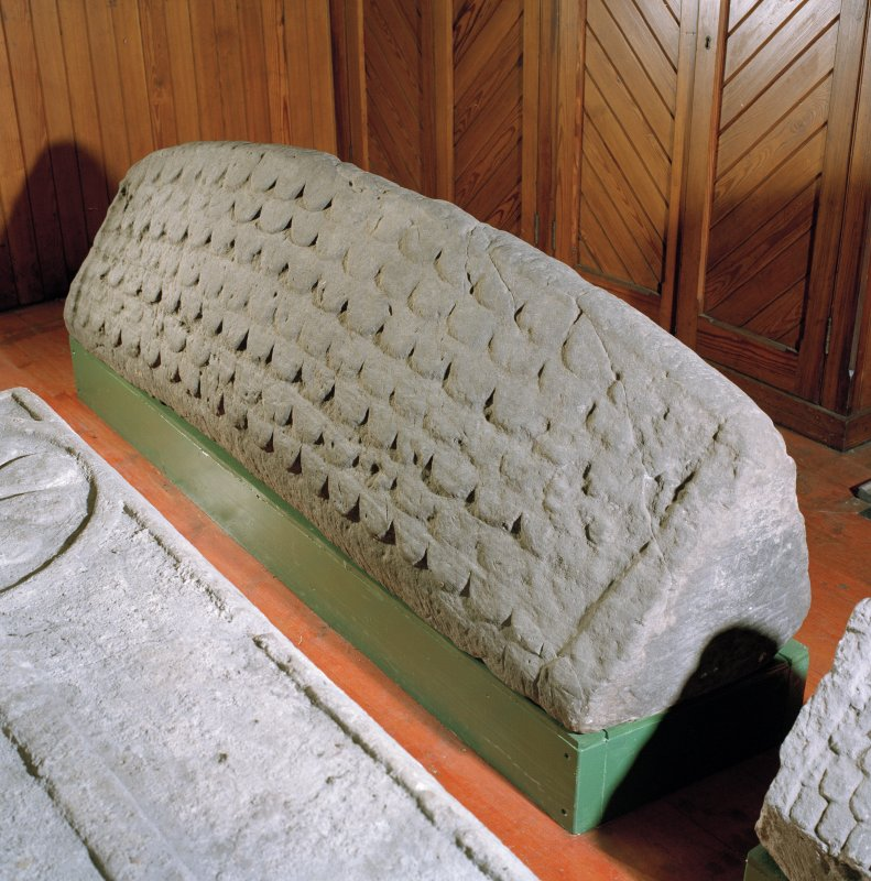Interior. Detail showing hog back stone.