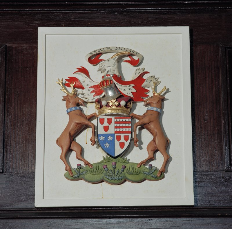 Interior. Detail of coat of arms on front of balcony