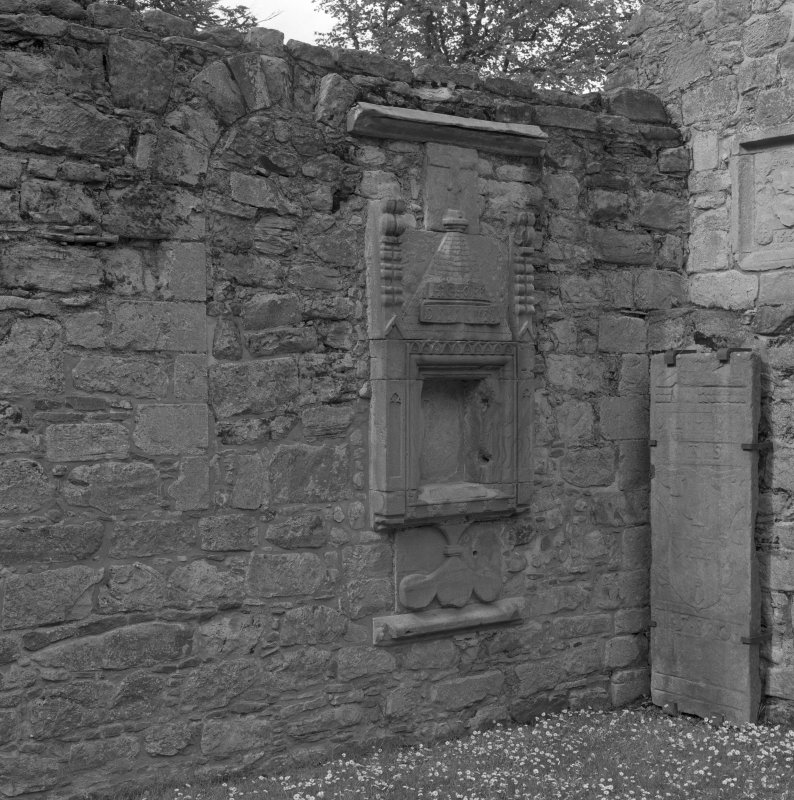 Sacrament house, blocked arched window and grave-slab.